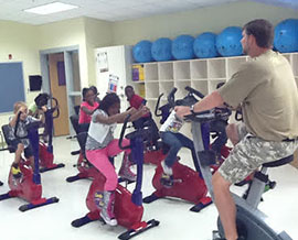 Everyone working out on stationary bikes at North Mitchell Elementary School.
