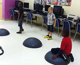 Kindergarten students enjoy physical activity in North Mitchell's new exercise room.
