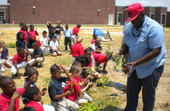 North Mitchell students are excited to receive plants for their garden plot.