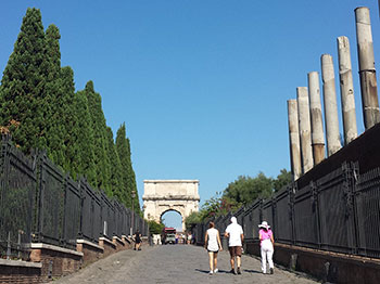 Roman road to triumphal arch.