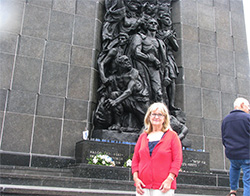 Sharmon Hagler at the Ghetto Uprising Memorial in Warsaw, Poland.