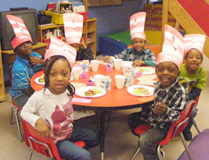 Students enjoy breakfast while reading Green Eggs and Ham
