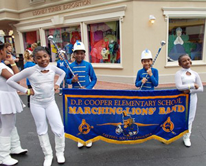 The Marching Lions' Band performs in the D. P. Cooper Homecoming Parade